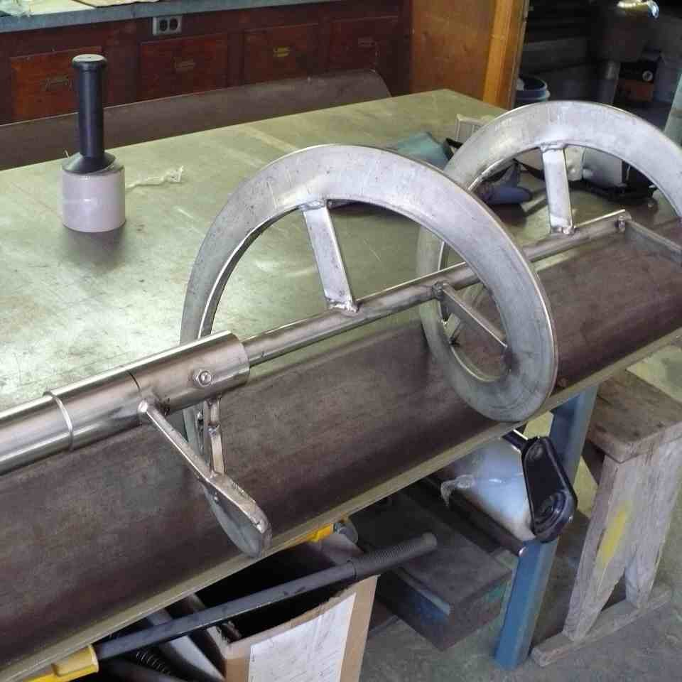 Custom built stainless steel auger on shop bench